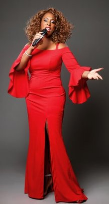 Whitney Houston tribute act by Levena red dress